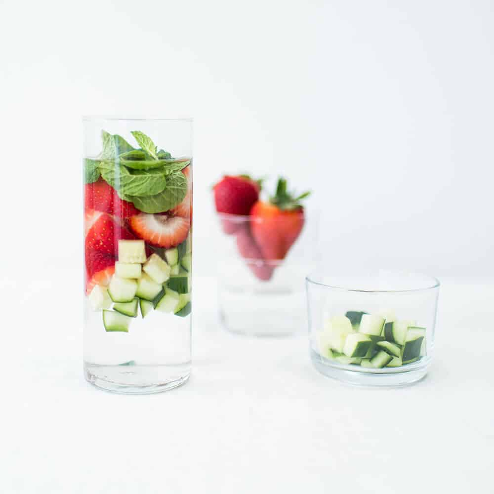 Glass of spa water with strawberries and cucumbers